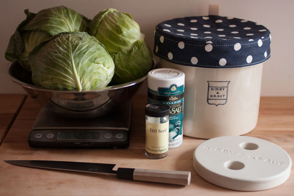 Cabbages, spices and crock for making sauerkraut