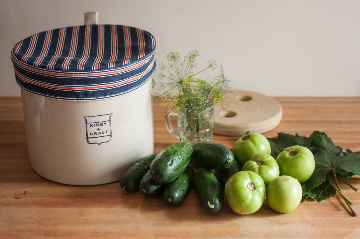 Fermentation crock with cucumbers and green tomatoes
