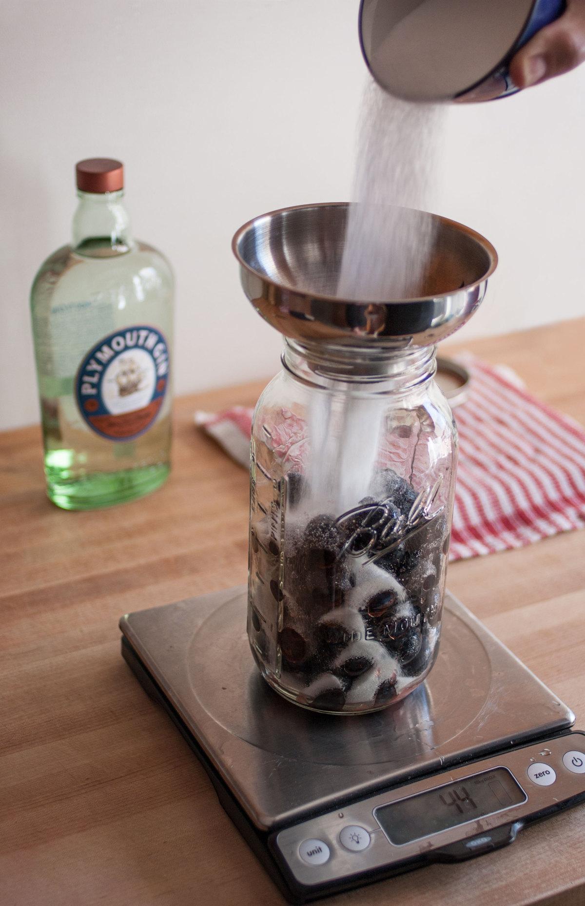 Adding sugar to damson gin